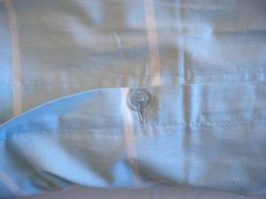 button closing detail on duvet cover